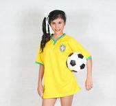 Beautiful woman hold ball with wearing Brazil football top — Foto Stock