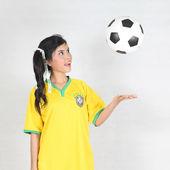 Half Portrait Beautiful woman throw up ball  with wearing Brazil — Foto Stock
