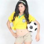 Portrait Beautiful woman hold ball with wearing Brazil football — Stock Photo #48511473