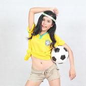 Beautiful woman hold ball with wearing Brazil football top — Stock Photo