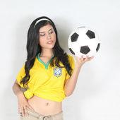 Portrait Beautiful woman hold ball with wearing Brazil football — Stock Photo