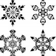 Stock Vector: Tribal snow flakes