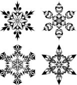 Tribal snow flakes — Stock Vector