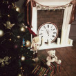 Christmas tree with decoration and gifts under it, cute bear and snowman , old fireplace and vintage watch , happy new year — Stock Photo