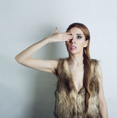 Girl in a fur gilets — Stock Photo