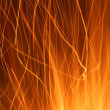 Stock Photo: Sparks from fire light trail