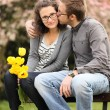 Kiss on a bench — Stock Photo