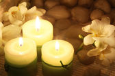 Candles and freesias — Stock Photo