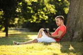 Tablet in park — Stock Photo