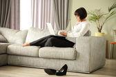 On sofa — Stock Photo