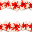 Holiday background with gift boxes and red bows. Vector. — Grafika wektorowa