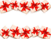 Holiday background with gift boxes and red bows. Vector. — Stok Vektör
