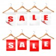 Wooden hangers with sale tags. Discount concept. Vector. — Stock Vector