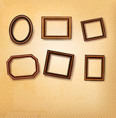 Wooden vintage frames on old wall. Vector illustration — Stock Vector