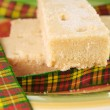 Three shortbread fingers with tartan ribbon — Stock Photo