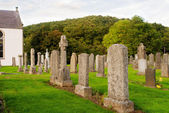 Old cemetery in Scottish country churchyard — Stock Photo