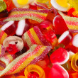 Mixed colourful fruit candies background — Stock Photo