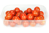 Cherry tomatoes in a plastic container on white background  — Stock Photo