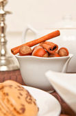 Canella and hazel-nut in white bowl — Stock Photo