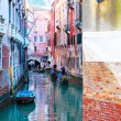 Venice canal with buildings and gondola — Stock Photo #22900118