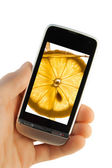Mobile phone with lemon splash — Stock Photo