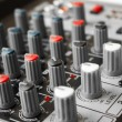 Detail of a music mixer in studio — Stock Photo #24605065