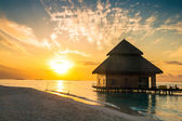 Sunset on Maldives island, water villas resort — Stock Photo