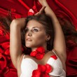 Beautiful sexy girl in Rose Petals — Stock Photo