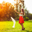 Portrait of young girl in a red skirt in park — Photo