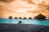 Over water bungalows with steps into amazing green lagoon — Stock Photo