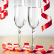 Two champagne glasses with a red ribbon — Stock Photo