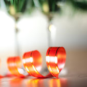 Red ribbon and a two champagne glasses — Stock Photo