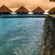 View of water villas resort on a Maldives island, shot with a tilt and shift lens — Stock Photo