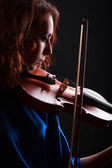 Violin playing violinist musician. Woman classical musical instrument player on black — Stock Photo