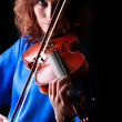 Violin playing violinist musician. Womclassical musical instrument player on black — Stock Photo #37721723