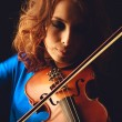 Violin playing violinist musician. Womclassical musical instrument player on black — Stock Photo #38727109