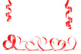 Ribbons shaped as hearts on white, valentines day concept — Stock Photo