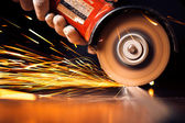 Red hot sparks at grinding steel material — Stock Photo