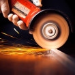 Red hot sparks at grinding steel material — Stock Photo #41545739