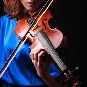 Playing the violin. Musical instrument with performer hands on dark background. — Stock Photo