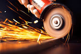 Red hot sparks at grinding steel material — Stok fotoğraf