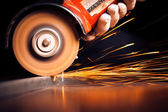 Red hot sparks at grinding steel material — Stockfoto
