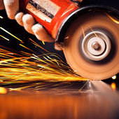 Red hot sparks at grinding steel material — Foto de Stock