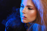 Woman with cigarette and smoke — Foto Stock