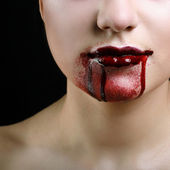 Closeup of Red lips of a young girl, with blood flowing by. — Stock Photo