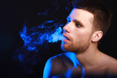 Close up portrait of young man smoking cigarette — Foto de Stock