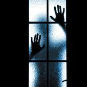 Scared boy behind glass door — Stock Photo