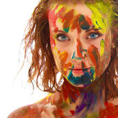Portrait of girl soiled in paint — Stock Photo