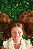 Cute redhead female lying down — Stock Photo
