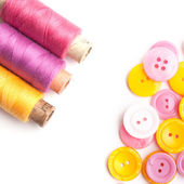 Closeup of thread and buttons — Stock Photo